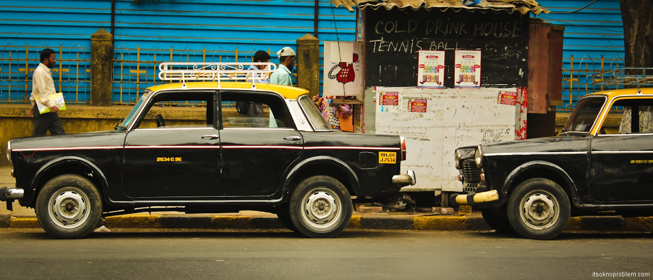Postcards from India. Taxis in Mumbai, buses, people and boots